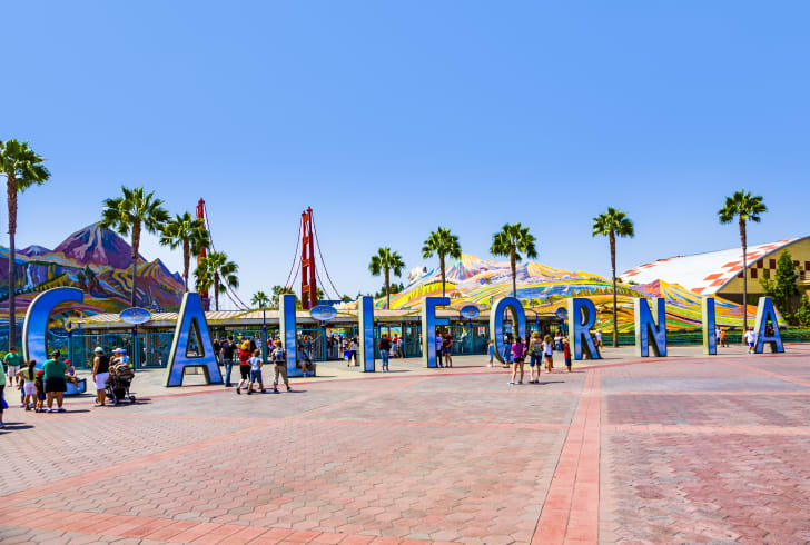 The entrance to a Disney park featuring giant letters that spell California.