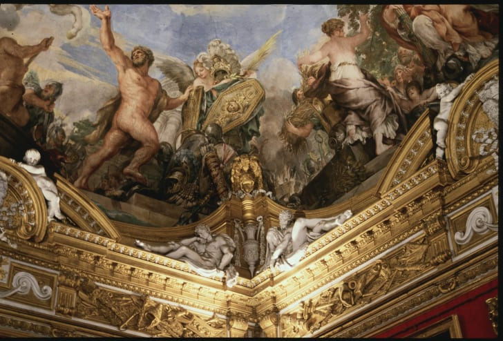 A painting on the ceiling of the Sistine Chapel.