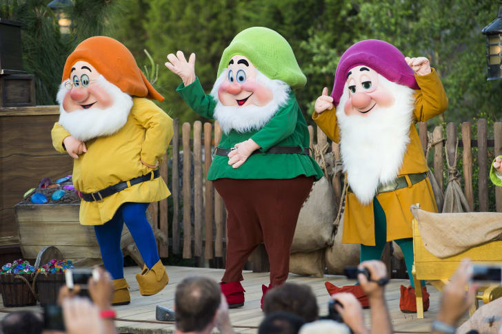 People dressed as Snow White's dwarfs.