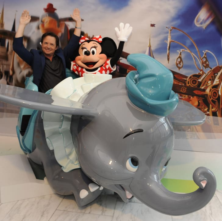 Minnie Mouse on a Dumbo ride.