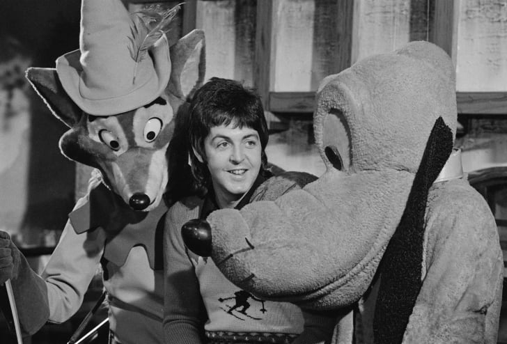 Paul McCartney hanging out with Pluto.