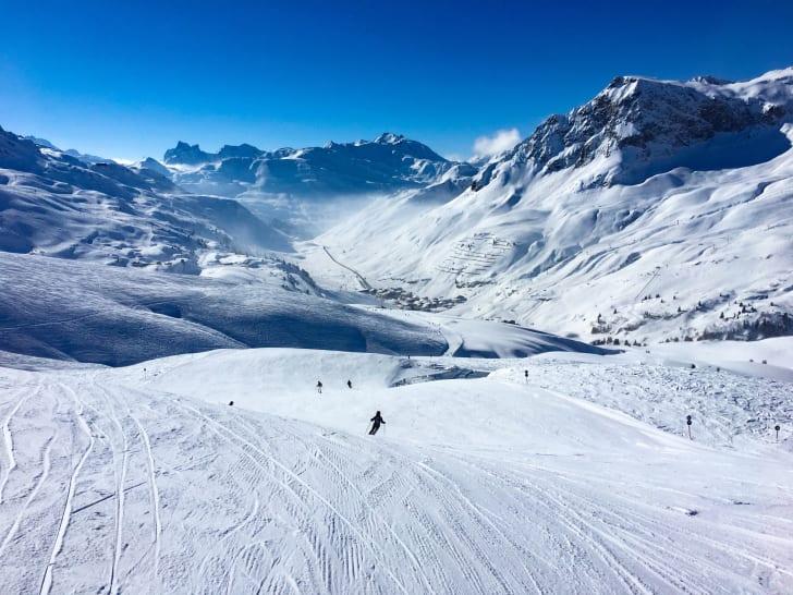 People skiing down a mountain.