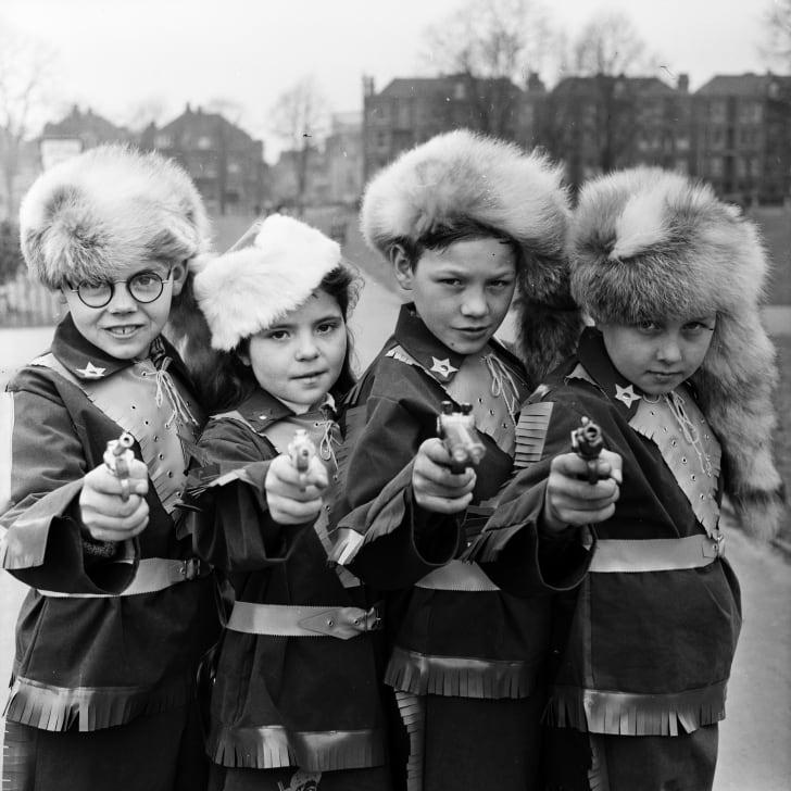Young boys dressed as Davy Crockett.