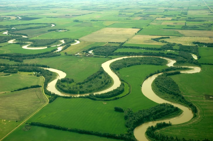 Curvy river in green landscape