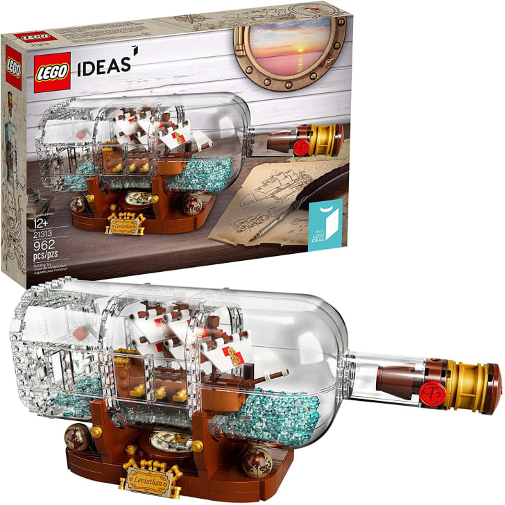 A LEGO ship in the bottle with the box.