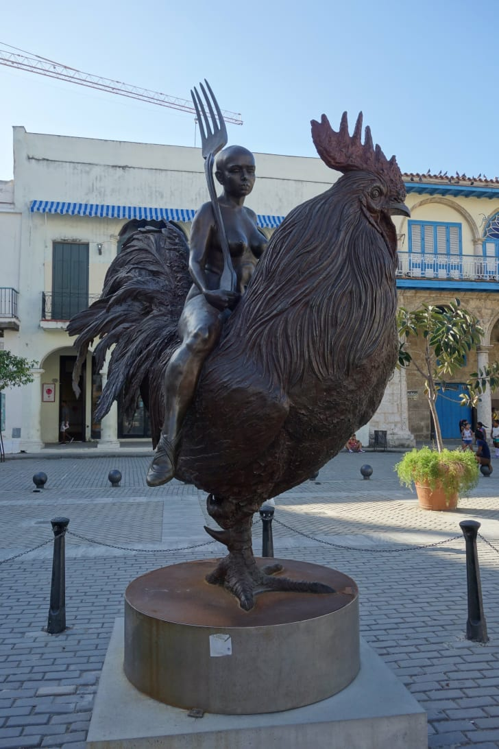 Sculpture of a naked lady on a chicken
