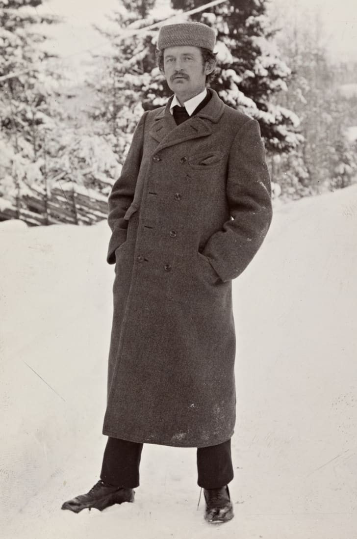 A portrait of Edvard Munch standing in the snow.