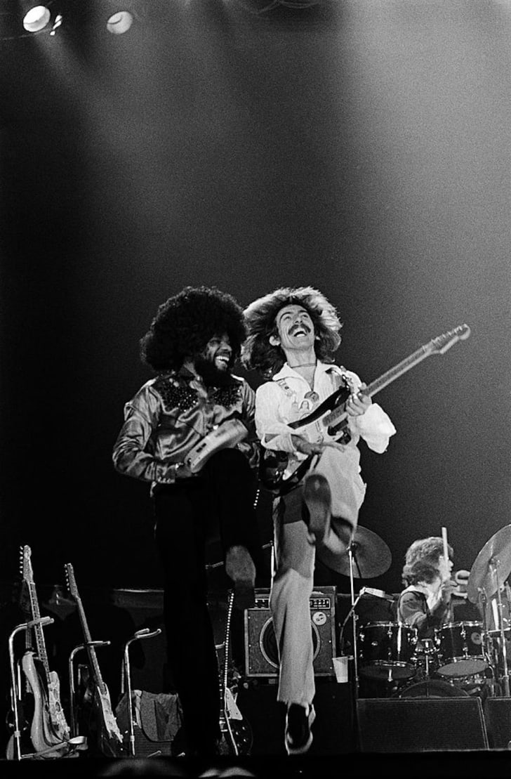 George Harrison and Billy Preston perform on stage at Maryland's Capitol Center in 1974.