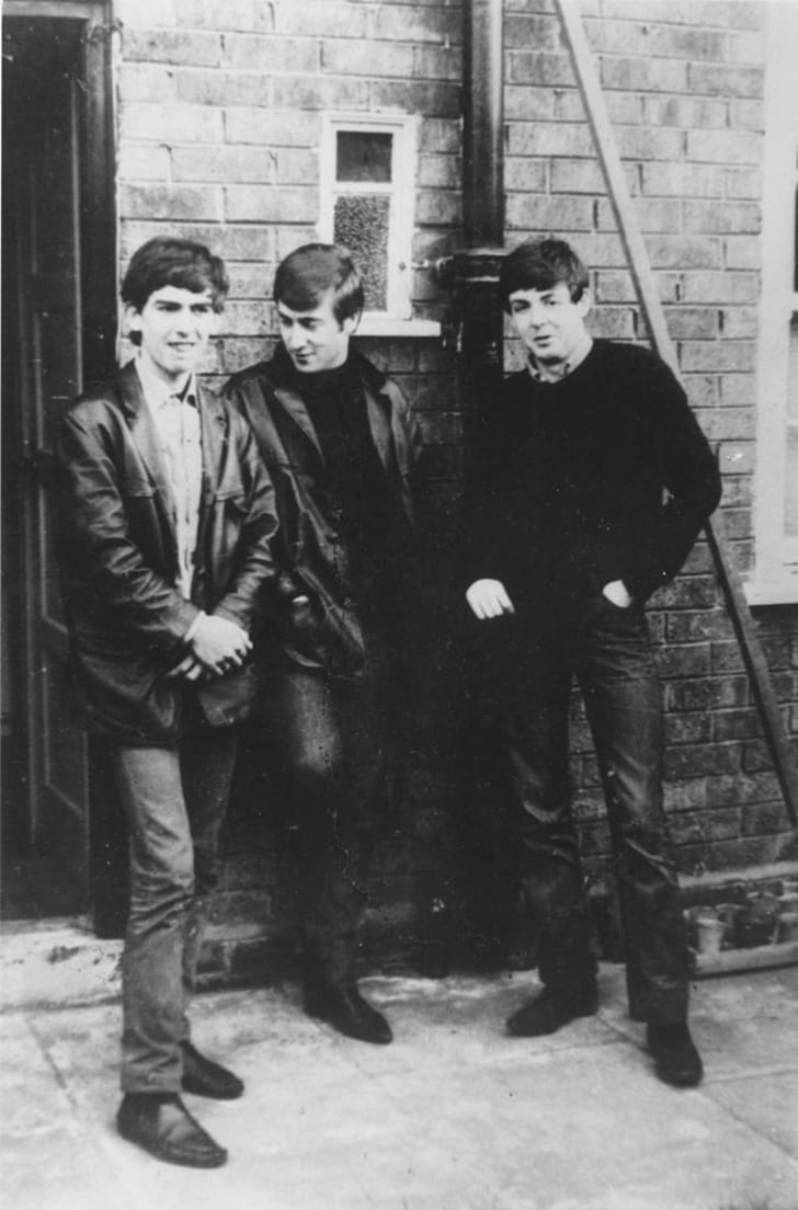 The Beatles standing outside Paul McCartney's Liverpool home circa 1960.