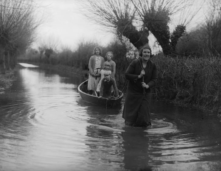 A mother towing her children to school at Burrowbridge near Bridgewater during severe flooding
