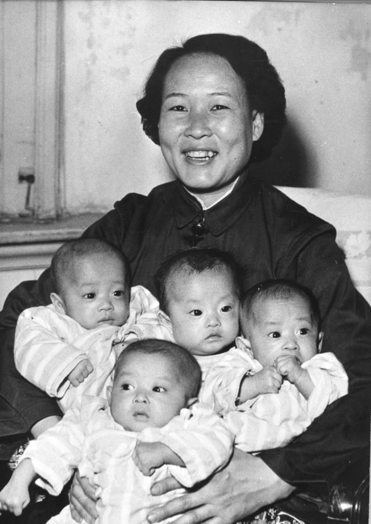 A proud mother displays her quadruplets