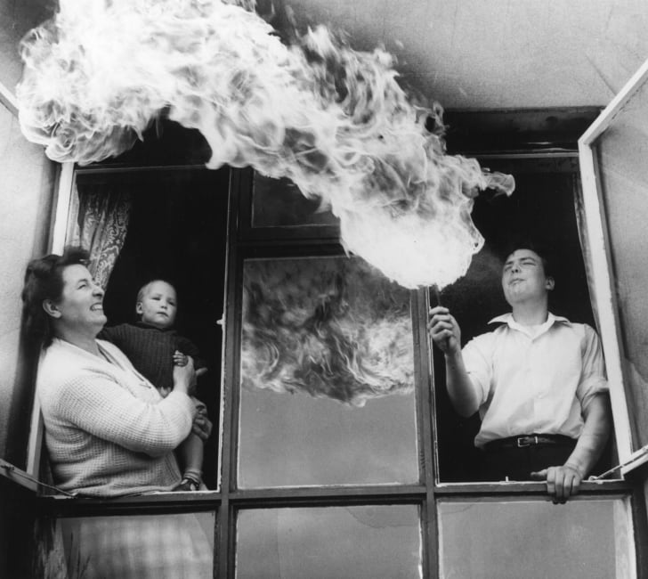 Sixteen year old trainee chef Peter Maddox of Hollingworth, Cheshire practises his hobby of fire-eating out of the window,