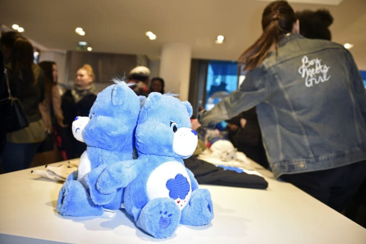 Two Care Bears are pictured at the Boy Meets Girl x Care Bears Collection at Colette in Paris, France in February 2017