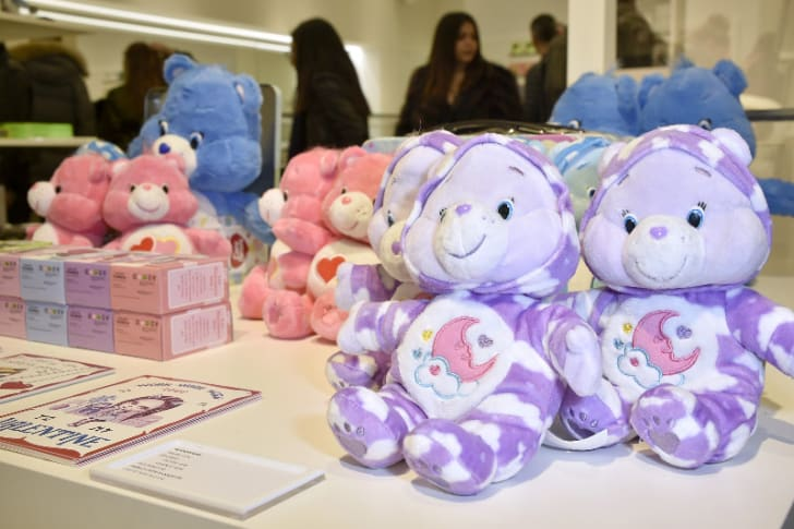 Several Care Bears are pictured on a table at the Boy Meets Girl x Care Bears Collection at Colette in Paris, France in February 2017