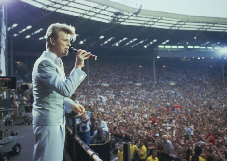 A photograph of David Bowie performing at the Live Aid concert in London on July 13, 1985.