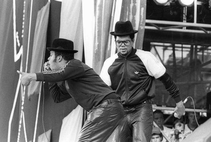 A photograph of Run-DMC performing at a Live Aid concert at JFK Stadium in Philadelphia in 1985.