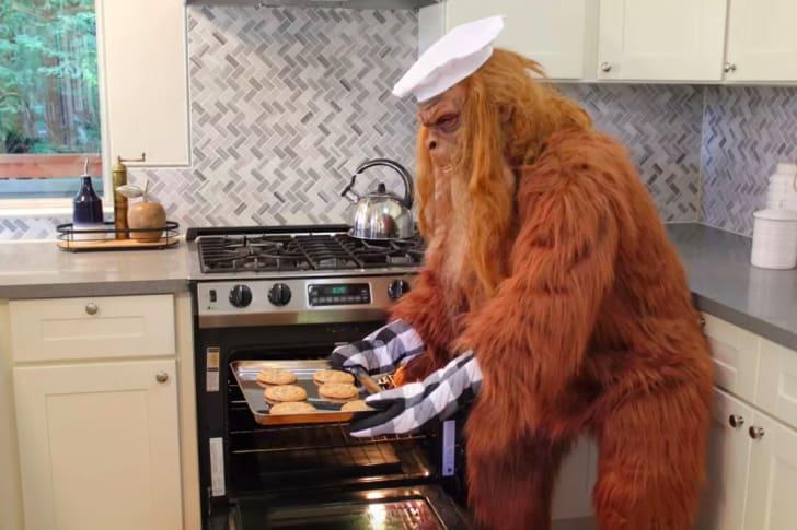 Bigfoot baking cookies.