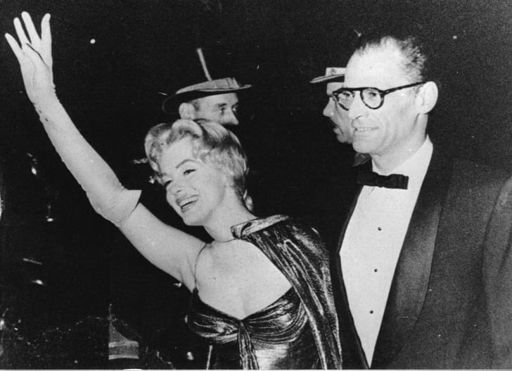Marylin Monroe waves to the camera with husband Arthur Miller on her arm in 1958.