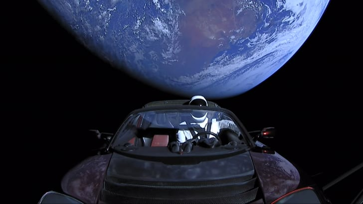 Elon Musk's Tesla Roadster, with Earth in background