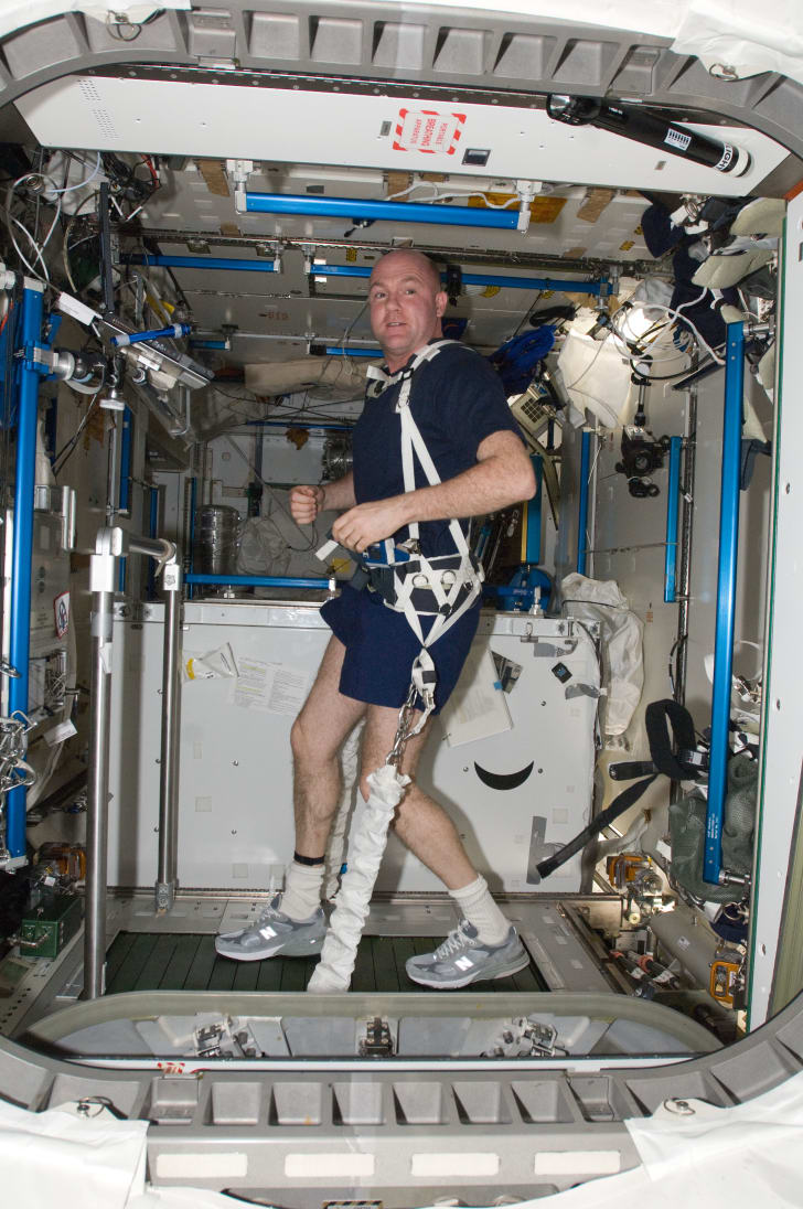 An astronaut using the COLBERT treadmill