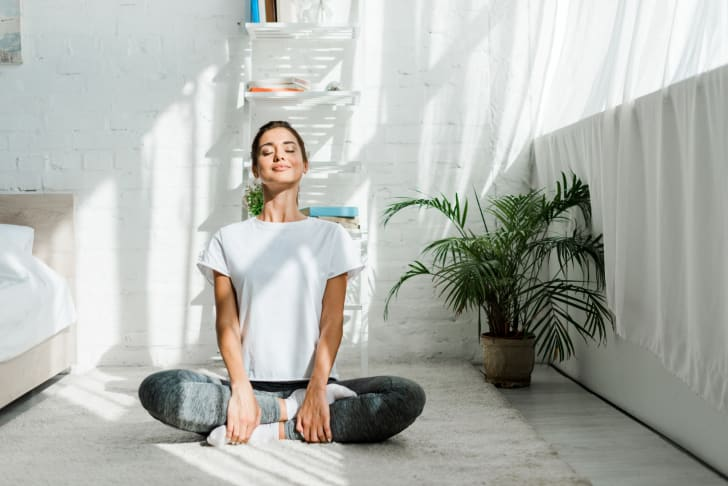 Person doing yoga at home.