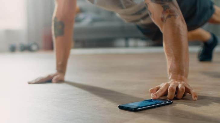 A person doing pushups at home.