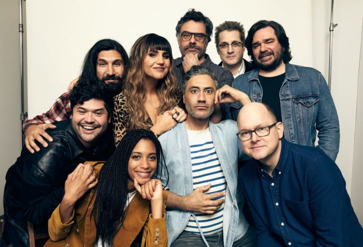 (Back row L-R) Harvey Guillen, Kayvan Novak, Natasia Demetriou, Jemaine Clement, Paul Simms, Matt Berry, (front row L-R) Stefani Robinson, Taika Waititi, and Mark Proksch of the film 'What We Do in the Shadows' pose for a portrait at SXSW in 2019.