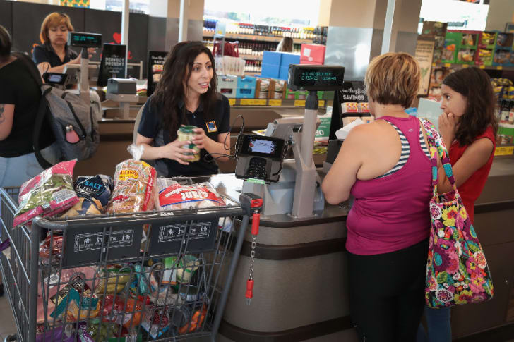 An Aldi employee is pictured ringing out a customer in Chicago, Illinois in June 2017
