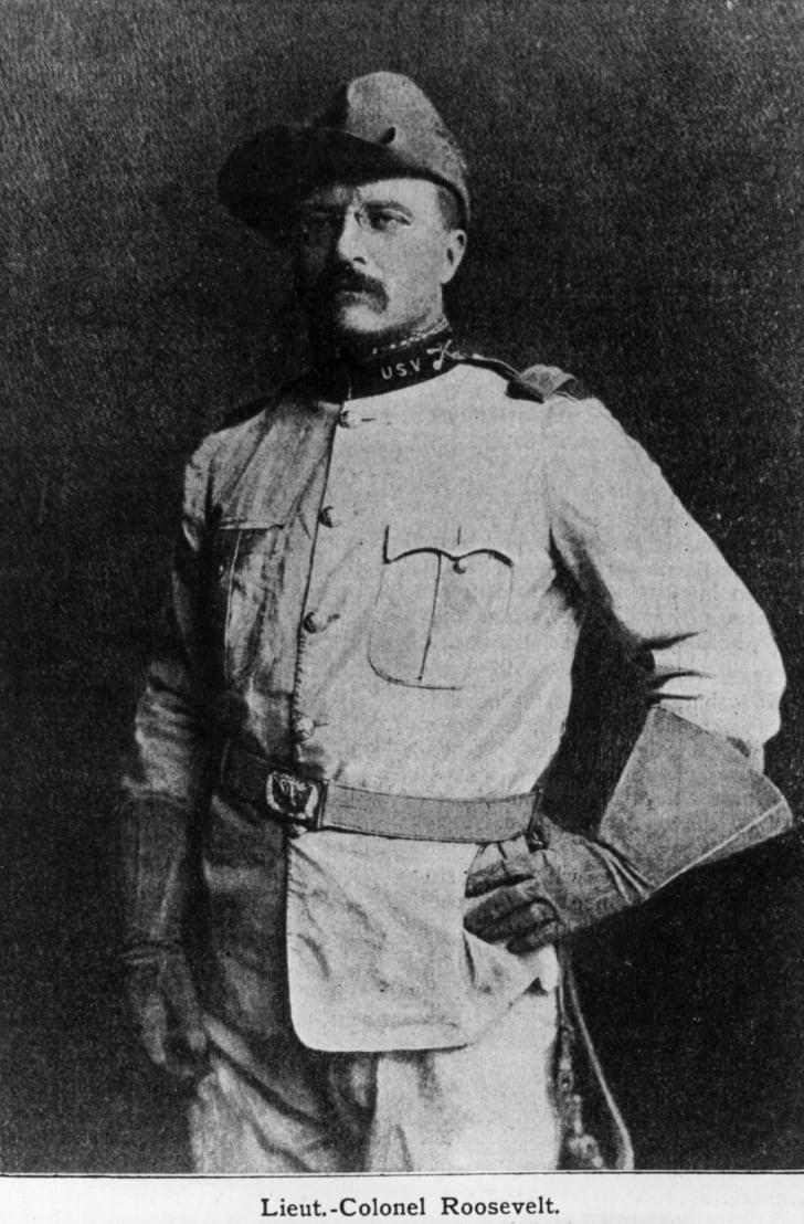 Theodore Roosevelt posing in his uniform.
