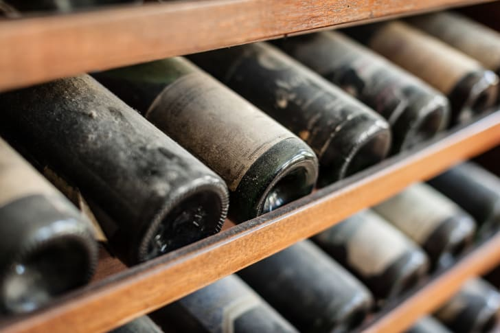 Dusty wine bottles in a rack