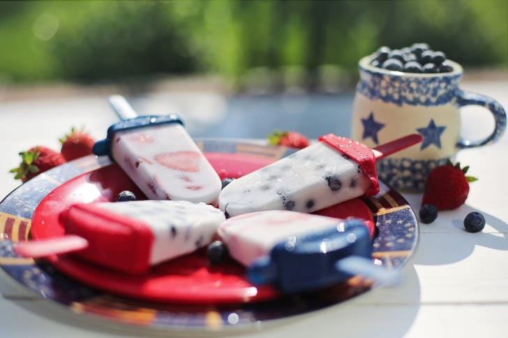 red white and blue popsicles on patriotic plates