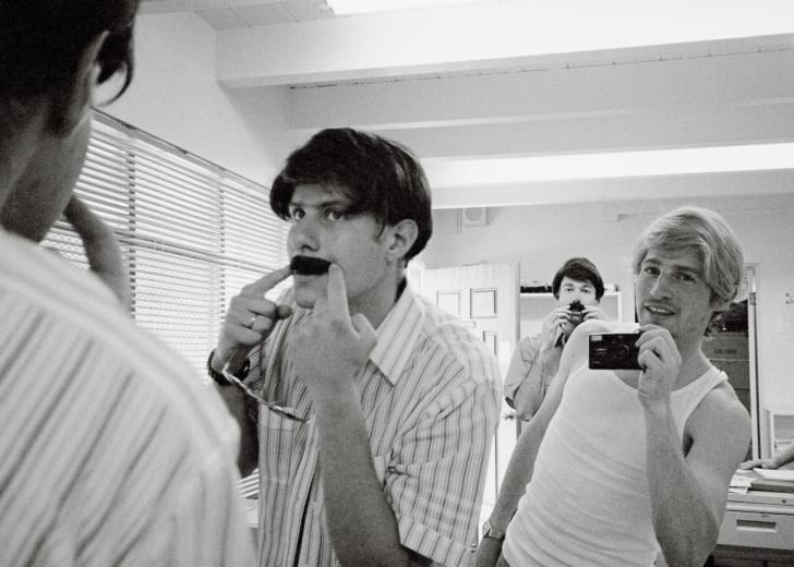 "Mike Diamond, Spike Jonze and Adam Yauch prepare for the ""Sabotage"" music video in a scene from ""Beastie Boys Story,"""