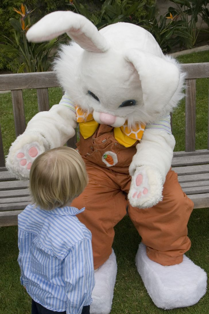 Easter Bunny greets a small child
