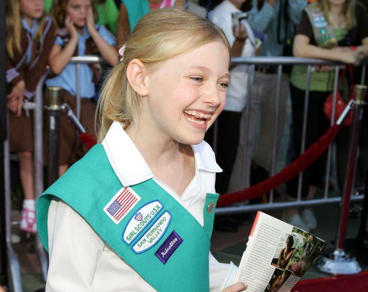 Dakota Fanning in Girl Scout uniform.