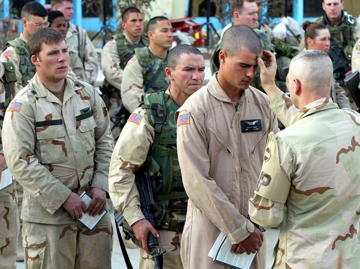 A minister performs an Ash Wednesday service at the Kandahar Airbase in Kandahar, Afghanistan in 2002.