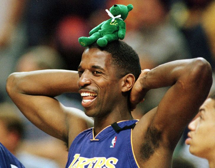 Los Angeles Lakers player A.C. Green stands with a green Beanie Baby bear on his head during a game in 2000.