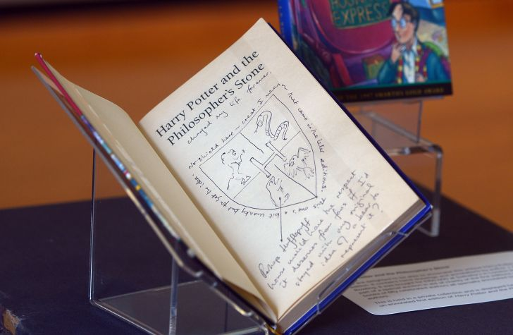 A signed early edition of 'Harry Potter and the Philosopher's Stone' on display