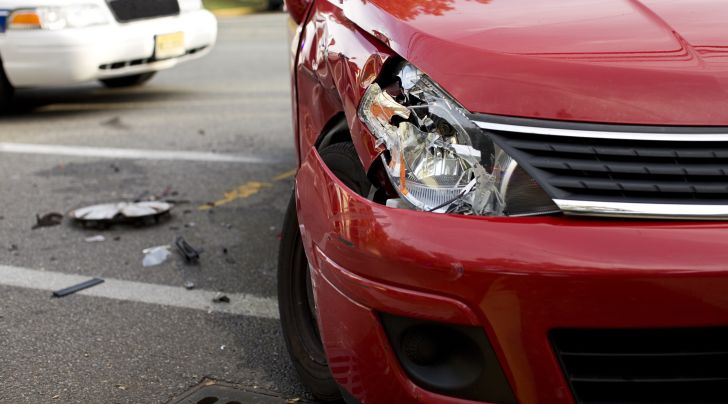 An image of a car with a broken headline after being in an accident.
