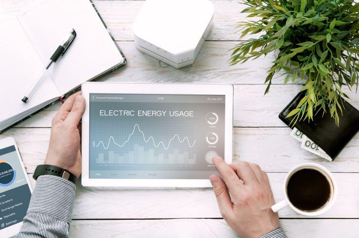 Man reviews an energy bill on a tablet app