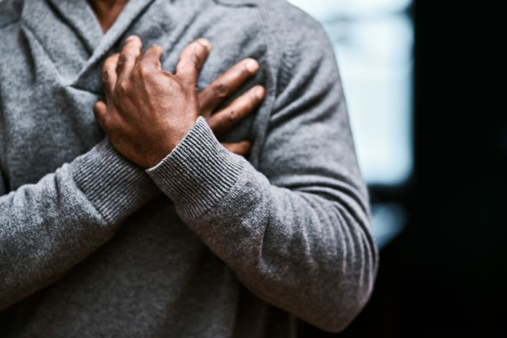 An image of a man grabbing his chest.