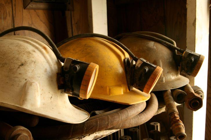 An image of mining helmets on a shelf.