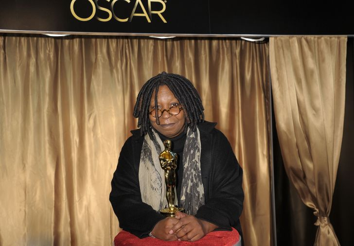 Whoopi Goldberg with her Oscar.