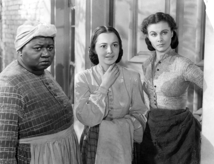 A publicity still from 1939's Gone with the Wind; at the 1940 Academy Awards, Hattie McDaniel (left) won the Oscar for Best Supporting Actress and Vivien Leigh (right) won Best Actress. Olivia de Havilland (center) was also nominated for Best Supporting A