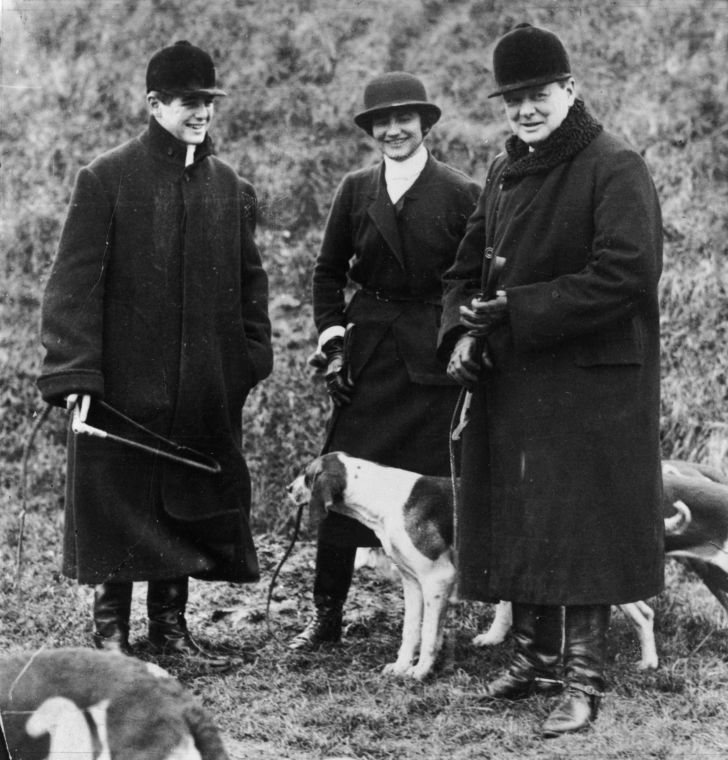 Winston Churchill (right) is accompanied by his son, Randolph, and Coco Chanel at a meet of the Duke of Westminster's boar hounds in northern France, circa 1928.
