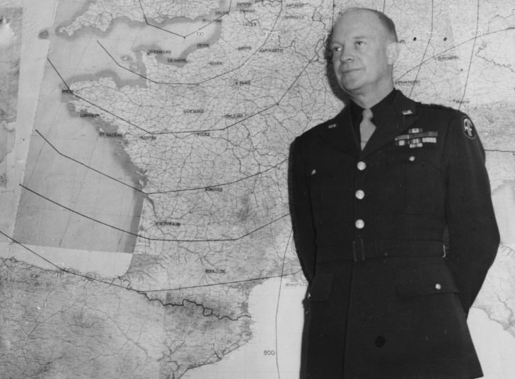 Dwight D. Eisenhower in front of a WWII map.
