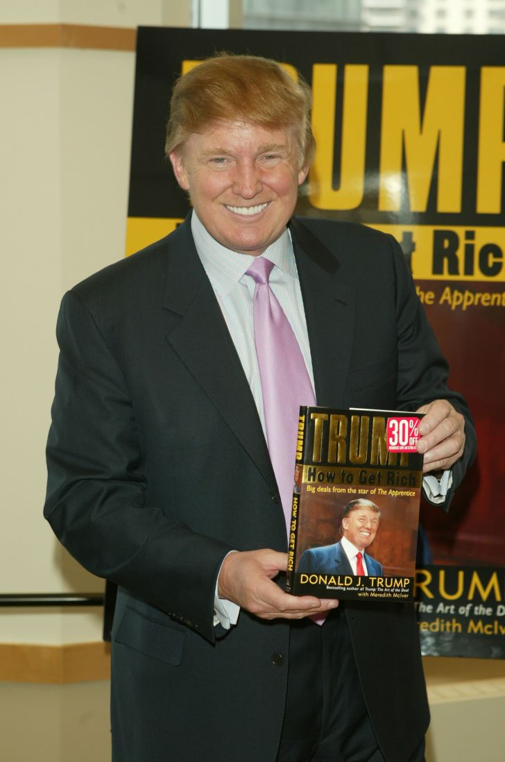 Donald Trump with a book.