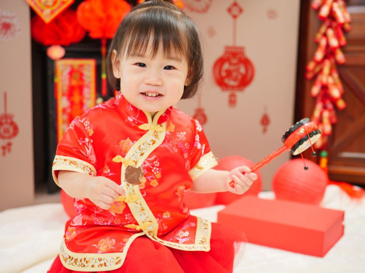 toddler dressed up for Chinese New Year