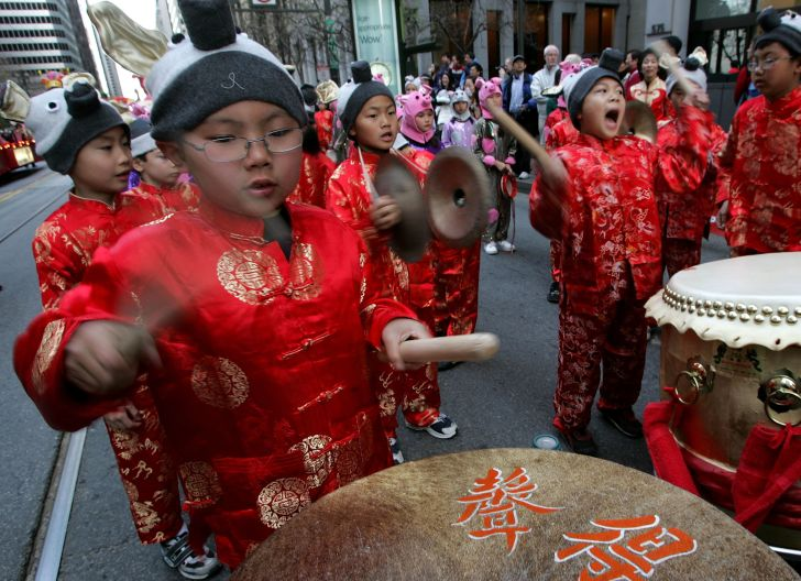 Children practice their drumming before the start of the Chinese New Year Festival and Parade in San Francisco, California.