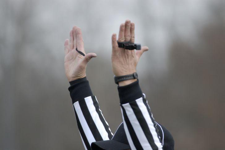 referee calling a touchdown