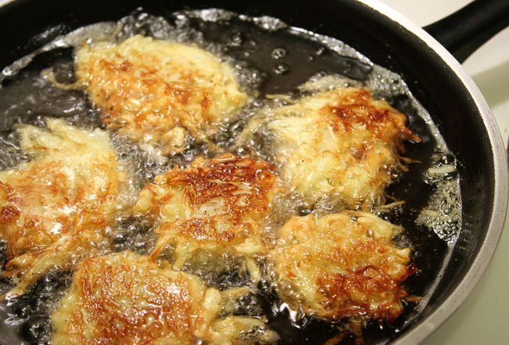 frying latkes in a pan
